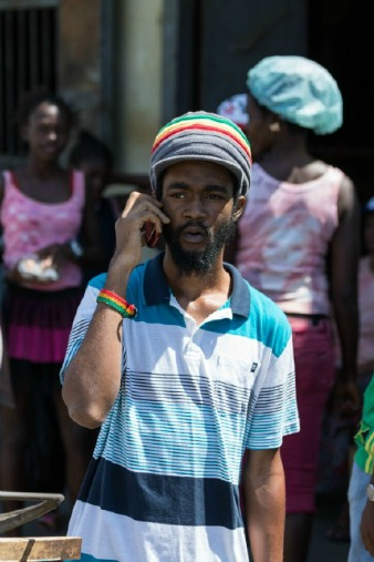 Jamaican man on phone